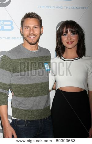 LOS ANGELES - JAN 14:  Scott Clifton, Ashleigh Brewer as the Bold and Beautiful Celebrates 7000th Show at a CBS Television City on January 14, 2015 in Los Angeles, CA