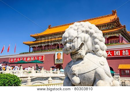 BEIJING, CHINA - JUNE 27, 2014: A lion statue guards at The Tiananmen Gate at Tiananmen Square.