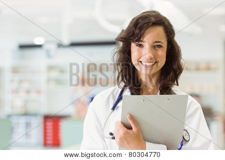 Pretty medical student smiling at camera at the university