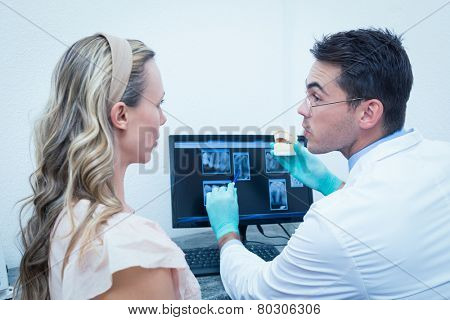 Side view of male dentist showing woman prosthesis teeth