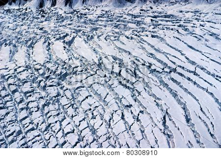 Aerial View of the Crumpled Ice Field of an Alaskan Glacier in the Great Alaskan Wilderness