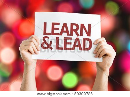 Learn & Lead card with colorful background with defocused lights