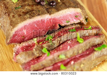 Delicious dinner of rare sliced roast beef