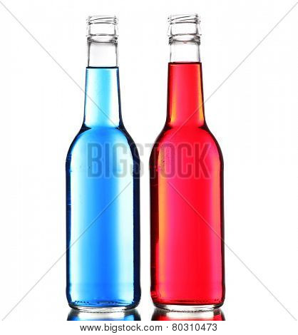 Colorful alcoholic beverages in glass bottles isolated on white