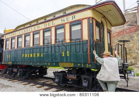 MOLLENDO, PERU, MAY 19, 2014:  Senior tourist visits Ferro Carilles del Sur train in open air museum