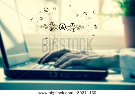 Hands of business woman with laptop keyboard.