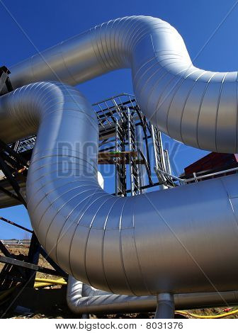 Industrial Zone, Steel Pipelines On Blue Sky