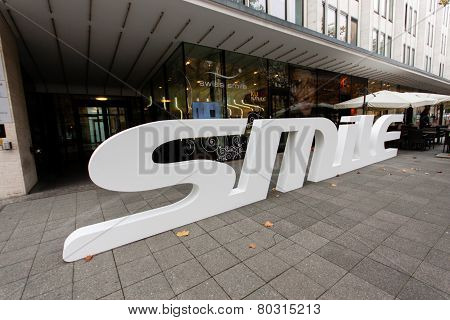 Berlin, Germany - November 12, 2014: Dental Care Shop Swiss Smile With 3D Logo On Pavement At Shoppi