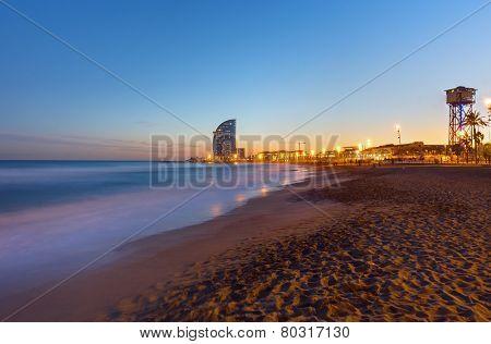 Beach in Barcelona at sunset