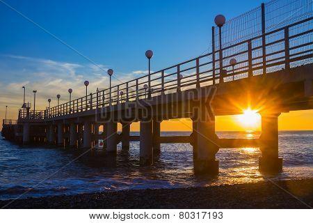 Sunset Through Pier