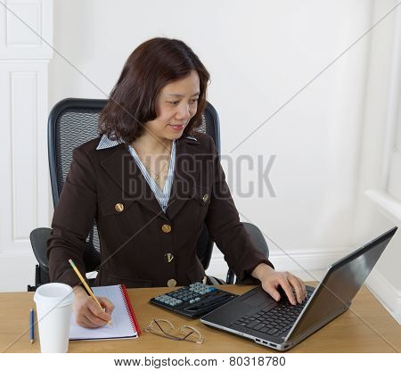 Happy Mature Woman At Work