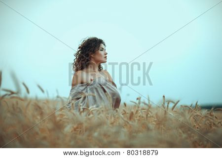 Girl In Profile A Field Of Wheat.