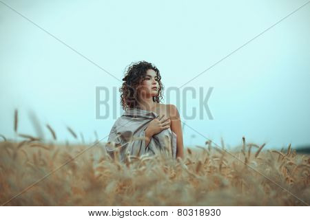 Girl In  Field Covered With A Cloth.