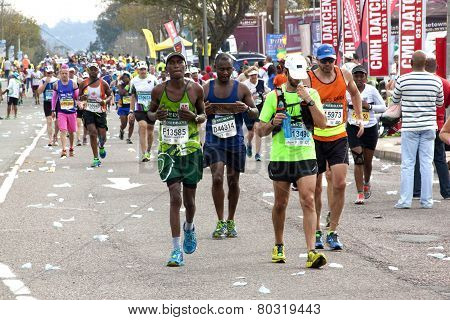 Colorful Participants Competing In The 2014 Comrades Marathon Road Race