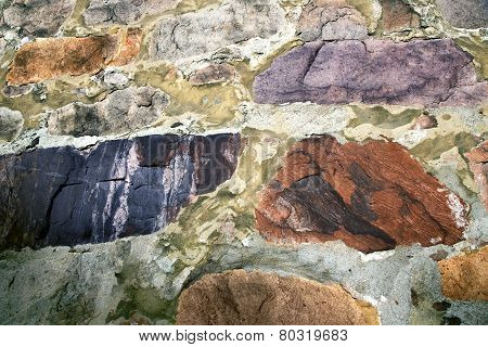 Old wall from colored stones