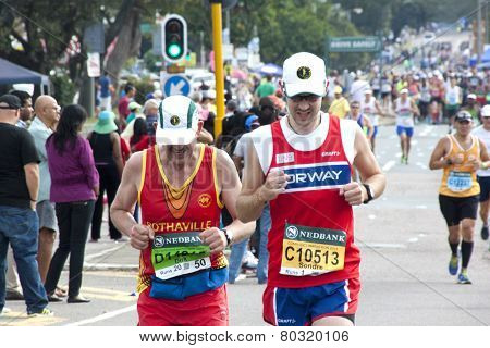 Young And Old Runners Competing In Comrades Marathon Road Race