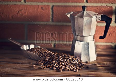 the coffee beans on wooden table