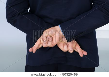 Businessman With Finger Crossed