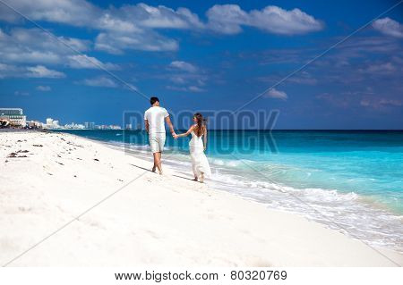 Young Beautiful Newlyweds On White Sandy Beach, Rear View