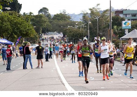 Participants Running In The 2014 Comrades Marathon Road Race