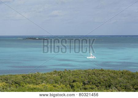 aerial view of catamaran moving through the caribbean sea