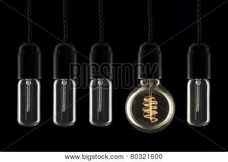 Vintage style lightbulbs with one turned on