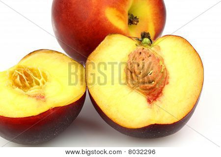 One whole and two nectarine halves