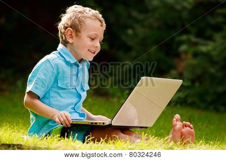 Smiling Boy On His Laptop
