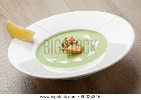 Green Broccoli Cream Soup Puree With Filleted Salmon  And  Lemon
