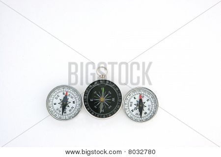three compasses