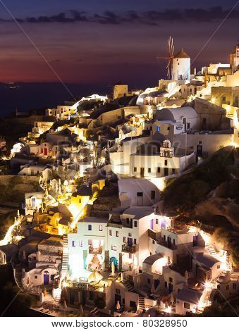Oia Village By Night In Santorini Island