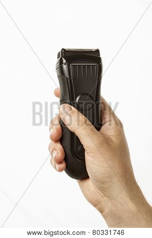 beard clipper in hand