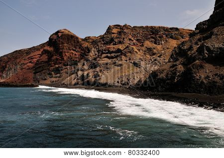 Waves And Rugged Cliff