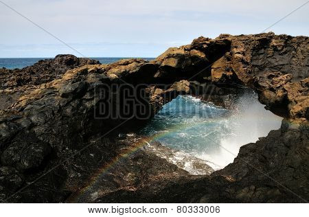 Natural Arch And Rainbow
