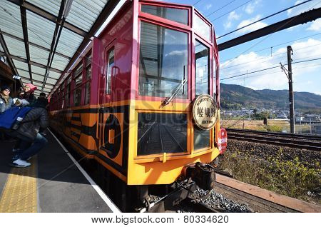 Tourist Take Photo Of The Train At Kameoka Torokko Station