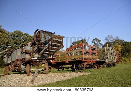 Threshing machine and hay racks