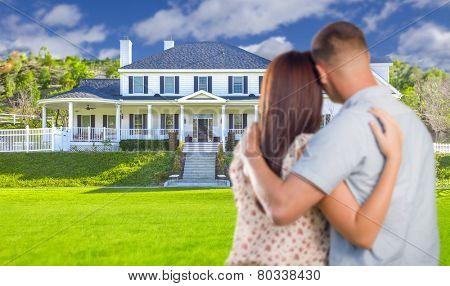 Affectionate Military Couple Looking at Nice New House.