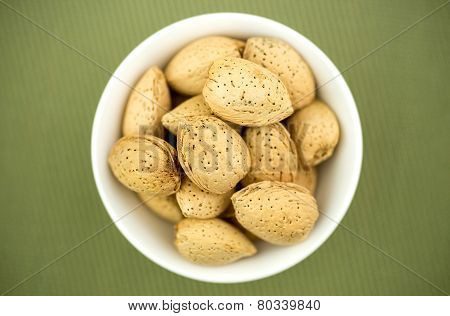 Un-cracked Natural Almonds In Shells In Bowl