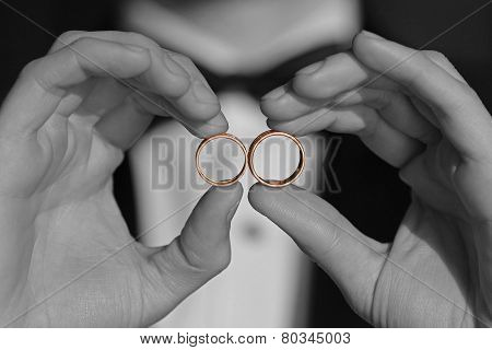 Golden Wedding Rings In Hands