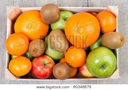A Small Wooden Crate With Fruits