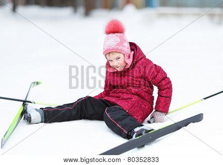 child engaged in skiing at winter