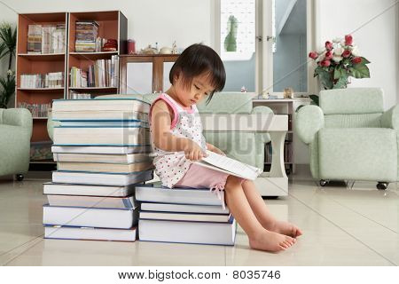 Litlle Girl Reading Lot Of Books