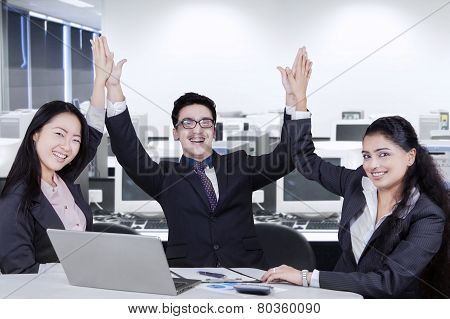 Cheerful Business Team Toasting Hands