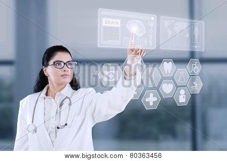 Doctor Using Futuristic Touchscreen Interface