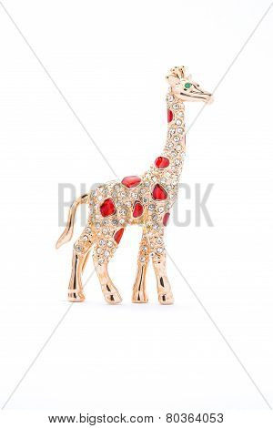 Giraffe Brooch On A White Background