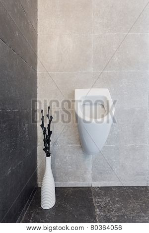 Urinal In Modern Bathroom