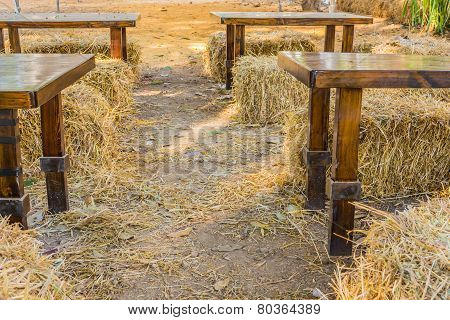 Hay On Ground  Background With Wooden Table.