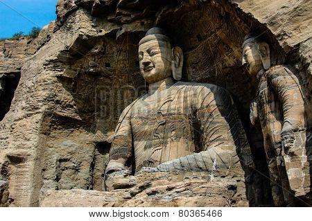 A very big Bodhisattva sitting in a cave