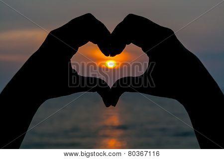 hand forming heart shape