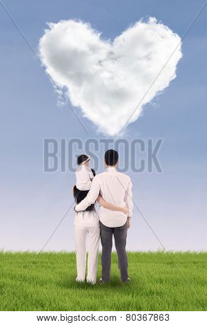Lovely Family Looking At Heart Symbol